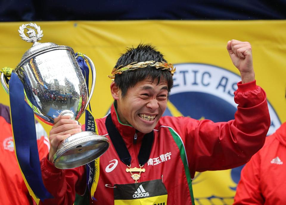 Yuki Kawauchi of Japan celebrates after winning the men's race at the Boston Marathon.